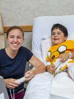 photo of Erin Carrick, Certified Child Life Specialist with burn center patient